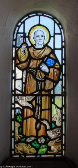 "Stainglass window in the porch ""In Memory of John Webber EBBS Rector of this Parish 1928-1943"""