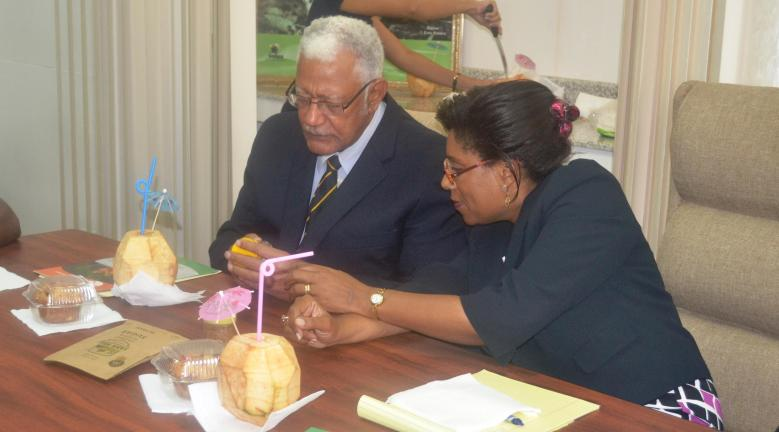 Ministers of Agriculture and Tourism examin some coconut biproducts during the Coconut Festival presentation briefing