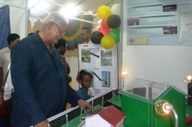 Minister Holder at the NDIA booth at Guyexpo