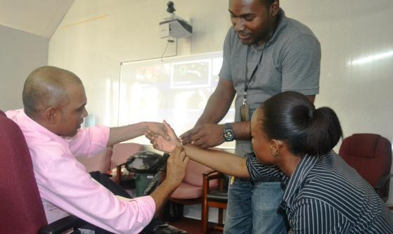 Facilitator showing participants how to check for a pulse