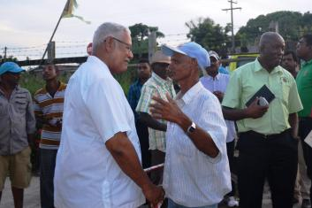 minister-holder-engaging-a-farmer-after-the-meeting