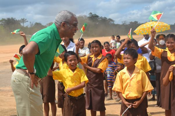 President Granger shares a light moment with students during visit to Iwokrama