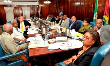 president-david-granger-fifth-from-right-and-members-of-his-cabinet-being-briefed-by-the-chief-executive-officer-of-the-guyana-sugar-corporation-guysuco-mr-errol-hanoman-at-cabinet-meeting-today
