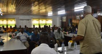 Agriculture Minister, Noel Holder addressing rice farmers during farmers' meeting