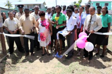Minister Amna Ally, commissions one of the shade houses built from the practical agriculture curriculum at the Lower Corentyne Secondary School.