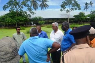 Minister Holder and other officials while visiting Arjoon's poultry farm