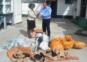 Permanent Secretary (ag), Mrs. Joylyn Nester-Burrowes recieves the donation from IICA Guyana Representative, Mr. Wilmot Garnett