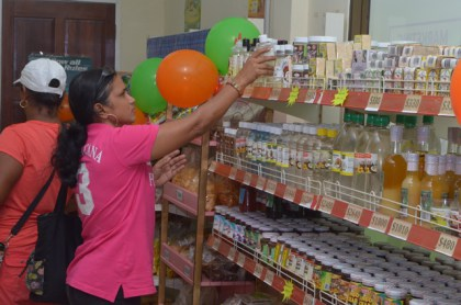 Customer shopping for locally produced goods at the Guyana Shop