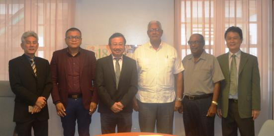Minister Holder with the team and NAREI CEO, Dr. Oudho Homenauth