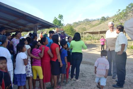 Minister Holder interacts with the Toshao and residents of Kanapang