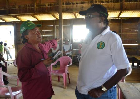 NAREI CEO, Dr. Oudhoo Homenauth engages in dialogue with a resident of Kurukabaru