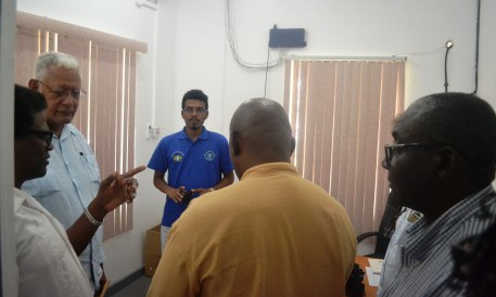 Minister Holder and other officials while touring the facilities