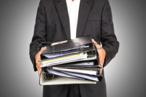52460208-businessman-is-holding-many-document-folders-front-side-business-busy-concept-include-clipping-path
