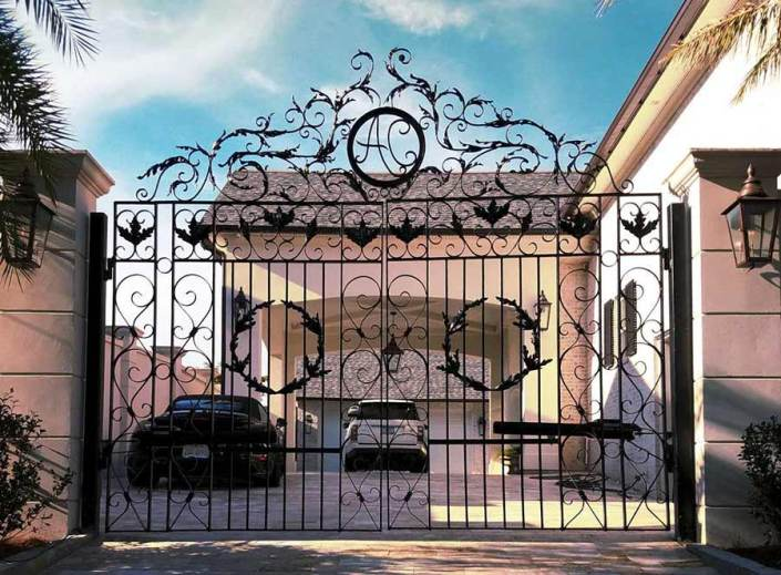 Dual Iron Swing Gates in Metairie, LA with Custom Fabrication (Front).