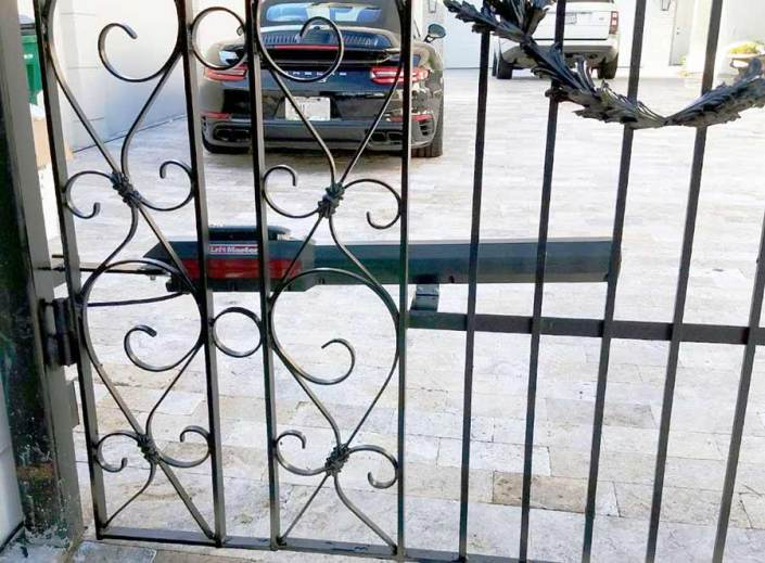 Dual Iron Swing Gate in Metairie, LA. Powered by Lift Master.