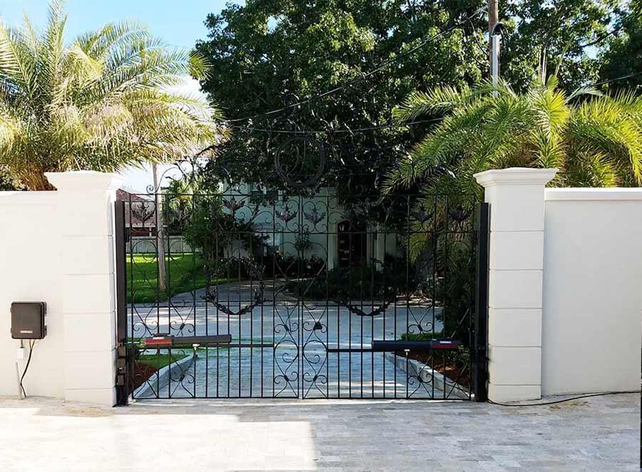 Dual Iron Swing Gate in Metairie, LA with Custom Fabrication (Back).