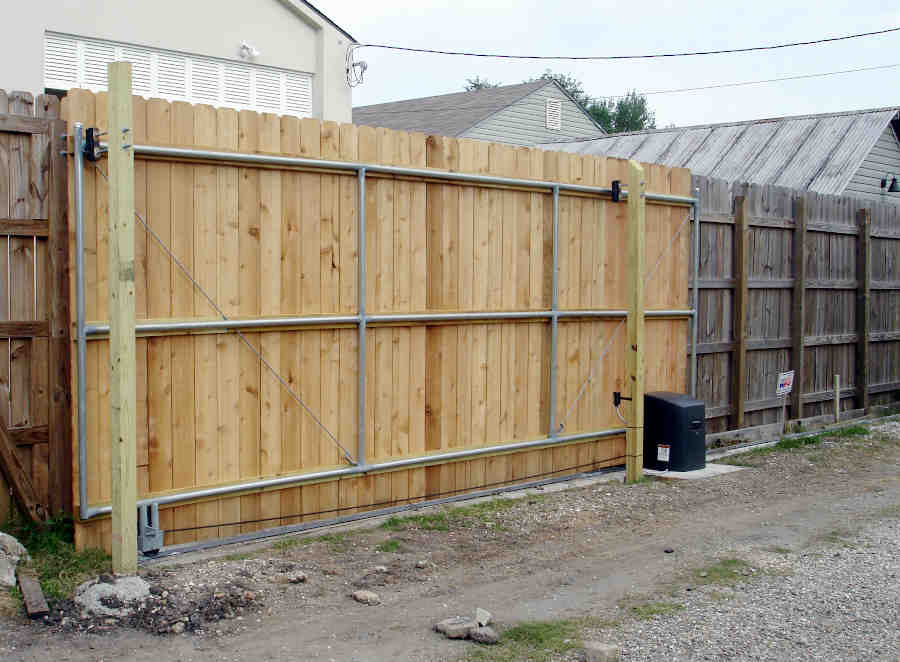 Sliding Roll Gate in Lakeview (Back). Wood Gate, Aluminum Frame. Single Vehicle Access.