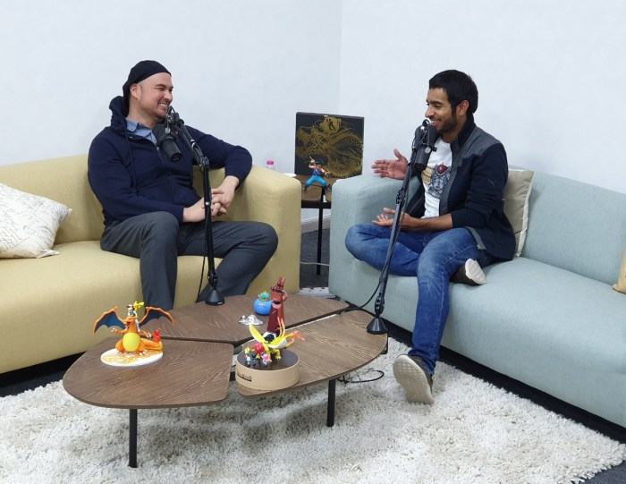Saeed al-Shamsi, right, founder of podcast Root Quest, interviews game developer Tarik Mukhtar at Sharjah Youth Center