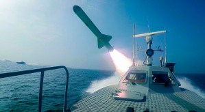 An Islamic Revolutionary Guard Corps speed boat fires a missile during a military exercise, July 28. (Sepahnews via AP)