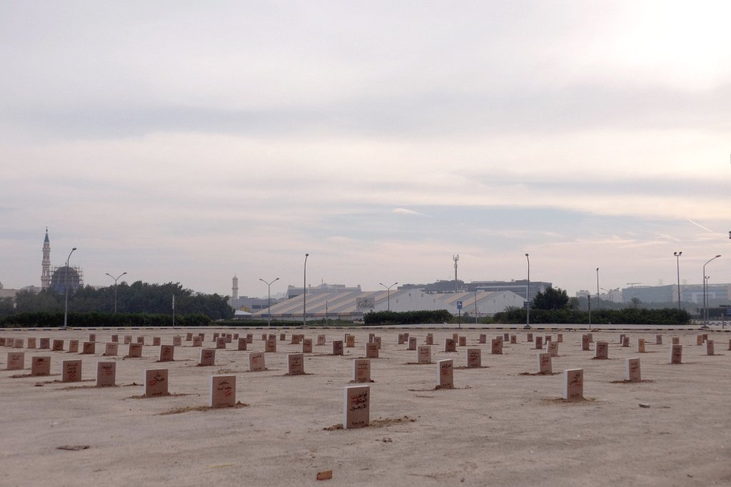 "A cemetery with the names of banned books on the gravestones and a stamp that says ""banned in Kuwait"" outside the Kuwait International Fairgrounds, where the annual book fair is held – November 22, 2018 (by Kuwaiti artist Mohammad Sharaf)"