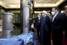 Iranian President Hassan Rouhani, second right, listens to head of the Atomic Energy Organization of Iran Ali Akbar Salehi while visiting an exhibition of Iran's nuclear achievements, Tehran, Iran, April 10. (Iranian Presidency Office via AP)