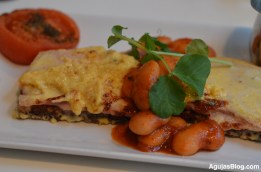 The Welsh Rarebit - toasted rye bread, savoury sauce of cheese, organic ham and baked beans.