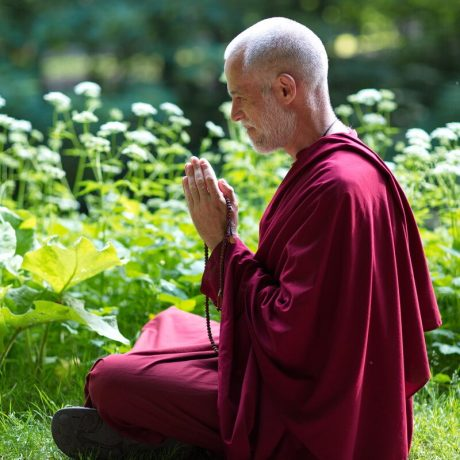 Lama Lakshyong in meditative pose in the forest