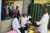 Dr Marijke Winroks and Margaret Mungai of Amref Health Africa in Kenya interact with staff at the health facility
