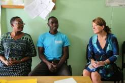 Dr Wijnroks interacts with a once a Multi-Drug Resisitant TB patient (middle) who benefited from the Global Fund programme
