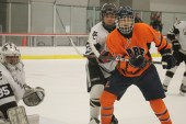 Forward #2 Sam Pecenka gains position in front of Mt. Carmel's netminder.