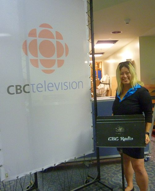 April standing with CBC signs