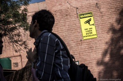 A board warns students about CCTV cameras