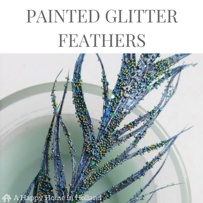 DIY PAINTED GLITTER FEATHERS - Learn how you can simply transform ordinary feathers into beautiful glittery home decor accents in this simple to follow step by step tutorial over on https://ahappyhomeinholland.com