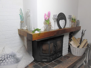 home decor image showing woodburner and spring decor on the mantel