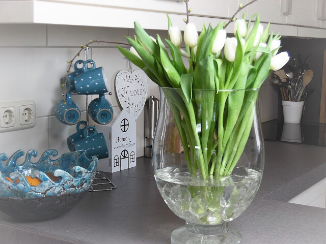 White Tulips Displayed In Oversized Glass Vase