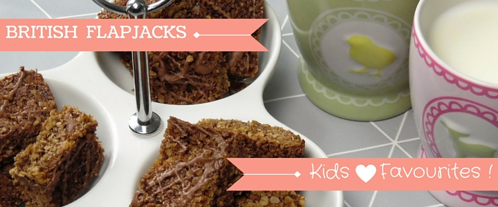 Chocolate Flapjacks Displayed In Dish Next To Child's Milk Drink