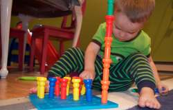 My son playing with a pegboard