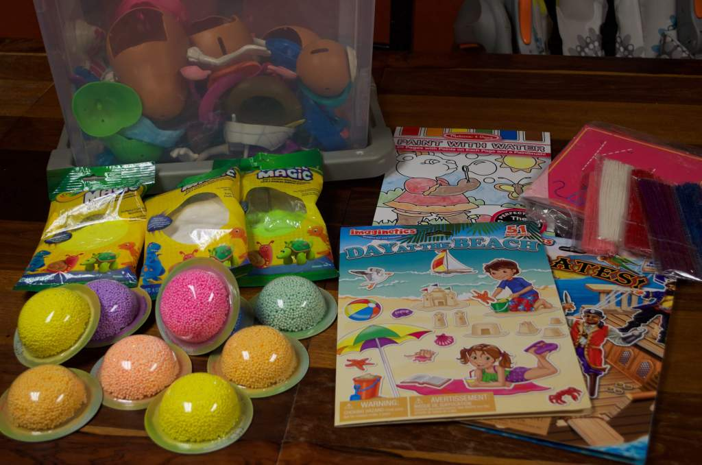 Items pictured include sticker books, Wikki Sticks, Floam.