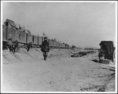 Jack Casement walking alongside work train