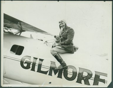 Early aviator Roscoe Turner with pet lion cub Gilmore.  Roscoe Turner Papers, Box 113, Folder 7.