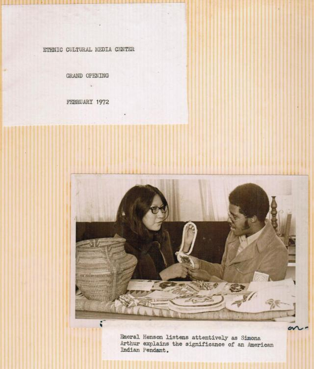 "Image of the MRC's opening day. Caption reads: ""Emeral Henson listens attentively as Simona Arthur explains the significance of an American Indian Pendant,"" 1972, box 3, folder 1, MRC Records, #541010, UW American Heritage Center."