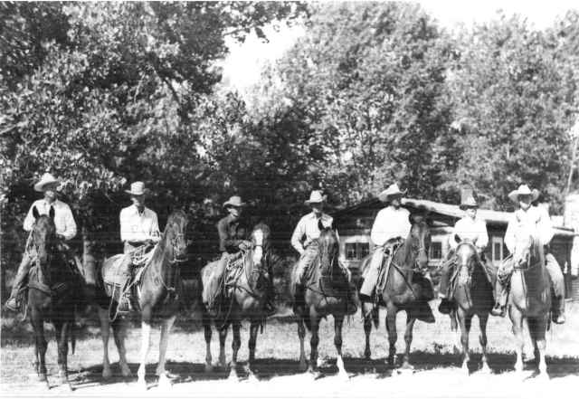 Wranglers at the Bones Brothers Ranch. From L to R: Little Bones, Gene Wood, Vern Thompson, Don Bard, Henry Bullen, Irving, Jr., Big Bones (Wales not pictured), undated. Wally Wales papers, #5643, Box 3, Folder 6.  UW American Heritage Center.