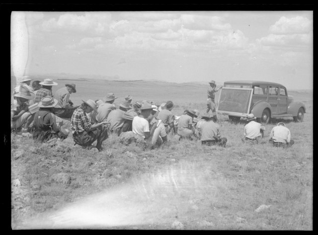 A geology course lecture, while en route to research site, ca. 1940. Samuel H. Knight Collection, #400044, Box 97. University of Wyoming, American Heritage Center.