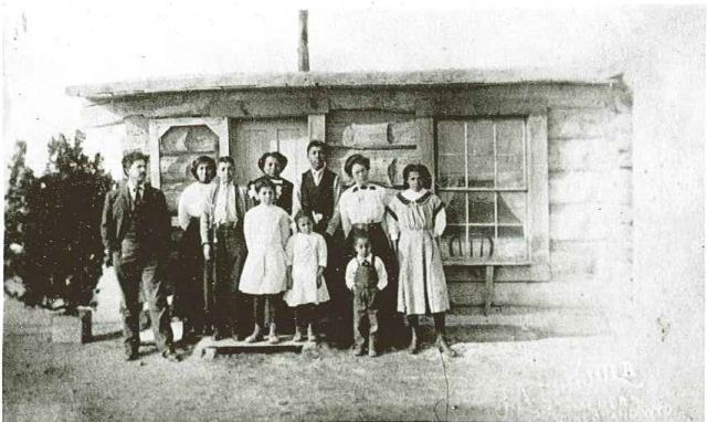 Alonzo Stepp Family in front of their homestead cabin near LaBarge, Wyoming, ca. 1920. Ranch-Stepp photograph file, American Heritage Center, University of Wyoming.