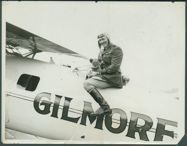 Roscoe Turner and Gilmore the Lion sitting on plane. Roscoe Turner papers, #5267, Box 113, Folder 7. University of Wyoming, American Heritage Center.