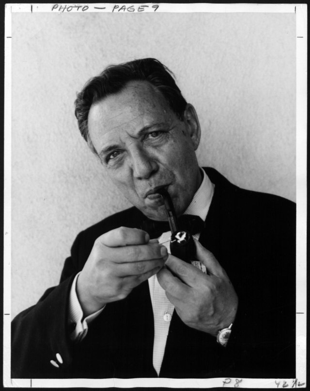 Photograph of Victor Gruen lighting his pipe. University of Wyoming, American Heritage Center, Victor Gruen Papers, Collection #5809, Box 56.