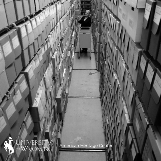 person getting box in archival space