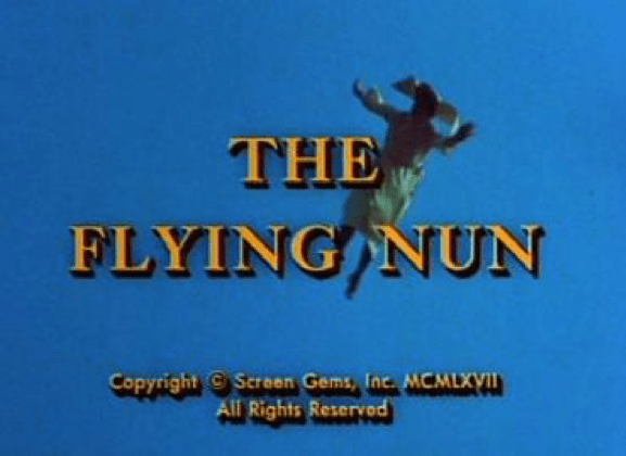 """image with """"The Flying Nun"""" text and nun flying in sky in background"""