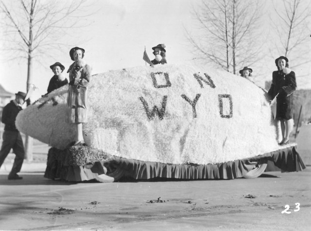people standing on homecoming float