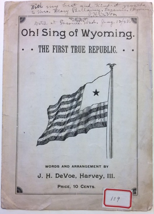 sheet music with flag and handwriting on it